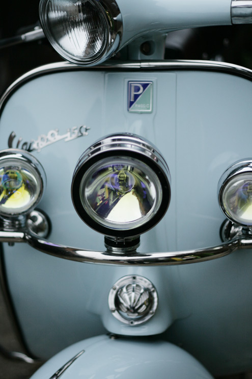 Front view of pale blue Vespa 150